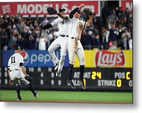 Playoffs Metal Print featuring the photograph Brett Gardner, Aaron Judge, and Aaron Hicks by Al Bello