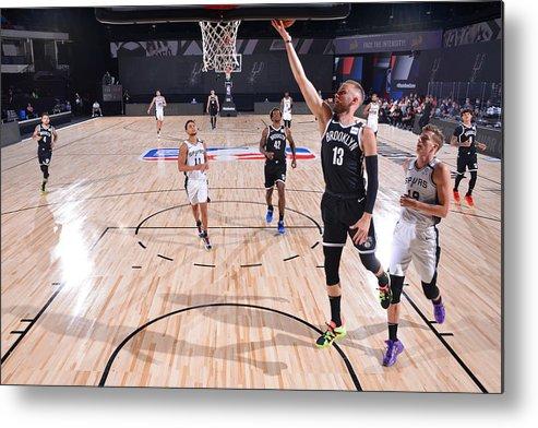Nba Pro Basketball Metal Print featuring the photograph Brooklyn Nets v San Antonio Spurs by Jesse D. Garrabrant