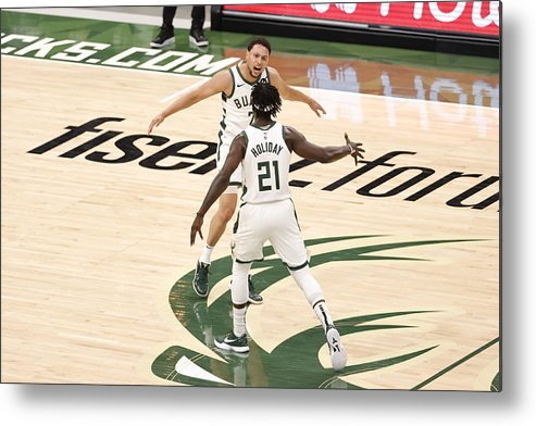 Playoffs Metal Print featuring the photograph Bryn Forbes and Jrue Holiday by Kamil Krzaczynski