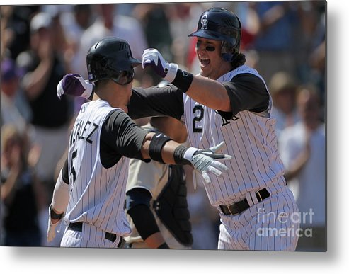 Scoring Metal Print featuring the photograph Carlos Gonzalez and Troy Tulowitzki by Doug Pensinger