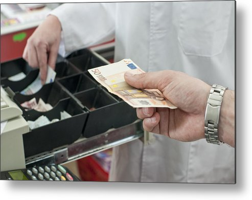 Young Men Metal Print featuring the photograph Cash In Hand Of Customer Paying In Supermarket by Chris Sattlberger