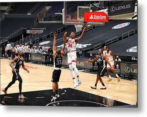 Nba Pro Basketball Metal Print featuring the photograph Chicago Bulls v LA Clippers by Adam Pantozzi