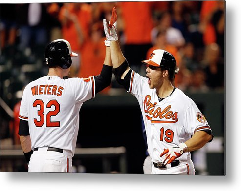 American League Baseball Metal Print featuring the photograph Chris Davis and Matt Wieters by Rob Carr