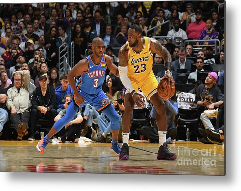 Nba Pro Basketball Metal Print featuring the photograph Chris Paul and Lebron James by Andrew D. Bernstein