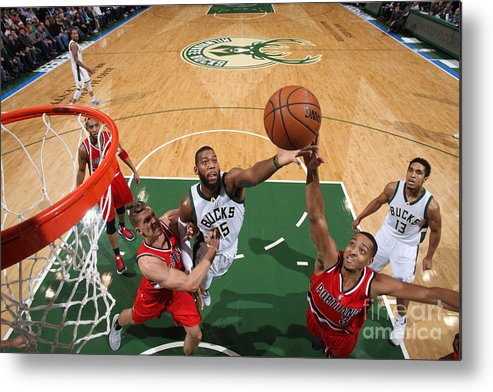 Nba Pro Basketball Metal Print featuring the photograph C.j. Mccollum and Greg Monroe by Gary Dineen
