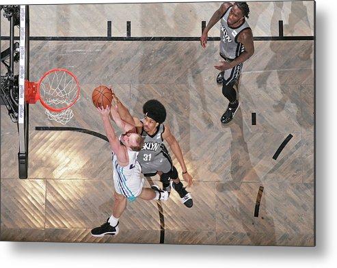 Nba Pro Basketball Metal Print featuring the photograph Cody Zeller and Jarrett Allen by Nathaniel S. Butler