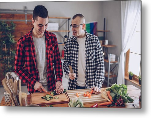 Young Men Metal Print featuring the photograph Couple Making Lunch Together by South_agency