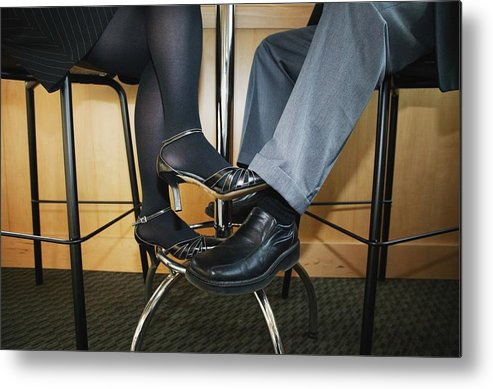 Heterosexual Couple Metal Print featuring the photograph Couple Playing Footsie Under the Table by Kelly Redinger