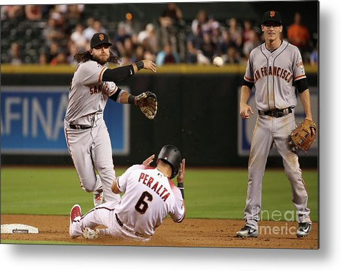 Double Play Metal Print featuring the photograph David Peralta and Brandon Crawford by Christian Petersen