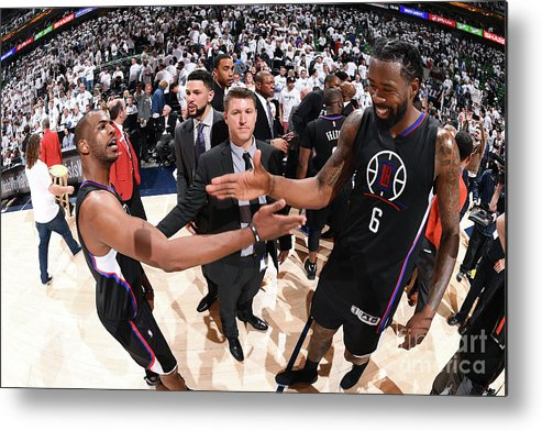 Playoffs Metal Print featuring the photograph Deandre Jordan and Chris Paul by Andrew D. Bernstein
