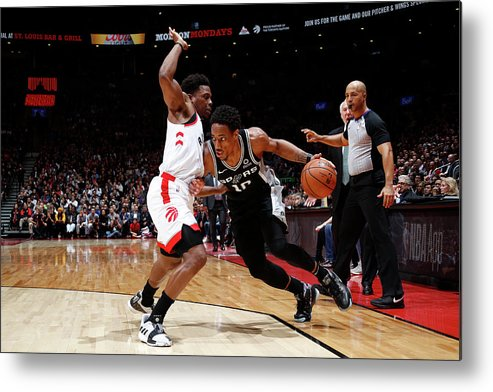 Nba Pro Basketball Metal Print featuring the photograph Demar Derozan and Kyle Lowry by Mark Blinch