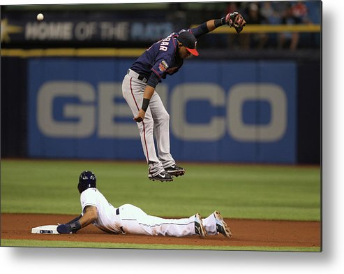 American League Baseball Metal Print featuring the photograph Desmond Jennings and Eduardo Escobar by Scott Iskowitz