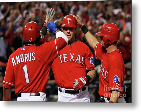 Playoffs Metal Print featuring the photograph Elvis Andrus, Michael Young, and Josh Hamilton by Stephen Dunn