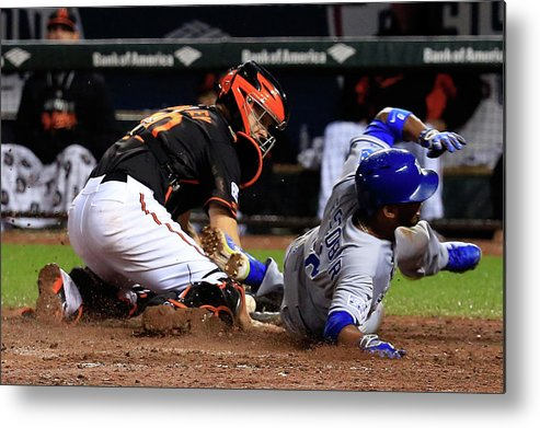 Ninth Inning Metal Print featuring the photograph Eric Hosmer, Nick Hundley, and Alcides Escobar by Rob Carr