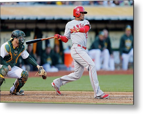 Following Metal Print featuring the photograph Erick Aybar and Stephen Vogt by Brian Bahr