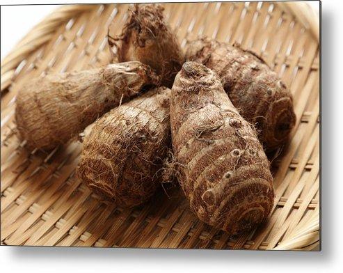 Shadow Metal Print featuring the photograph Fresh harvested, Satoimo potatoes.(taro, taro root). by Key05