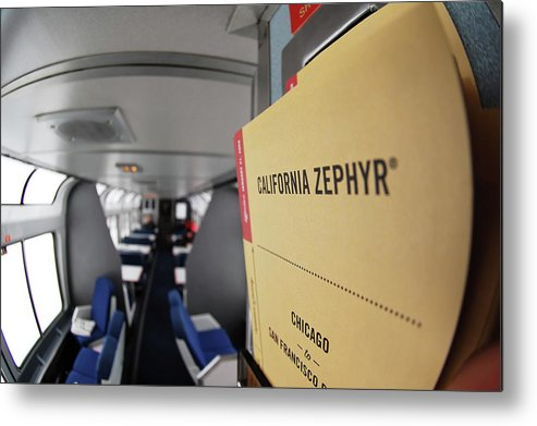 From Chicago To San Francisco Metal Print featuring the photograph From Chicago To San Francisco -- Timetable In The Lounge Car On The Amtrak California Zephyr by Darin Volpe
