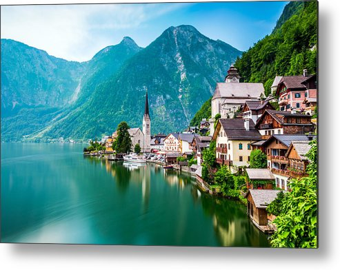 Water's Edge Metal Print featuring the photograph Hallstatt Village and Hallstatter See lake in Austria by Chunyip Wong