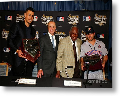 Game Two Metal Print featuring the photograph Hank Aaron and Giancarlo Stanton by Tim Bradbury