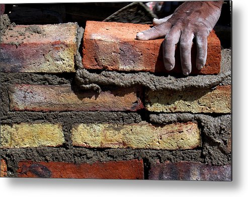 Working Metal Print featuring the photograph Human hand building brick wall by Memo Vasquez