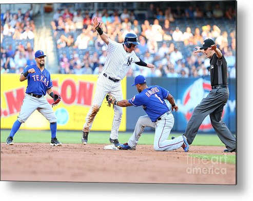 People Metal Print featuring the photograph Jacoby Ellsbury and Elvis Andrus by Mike Stobe