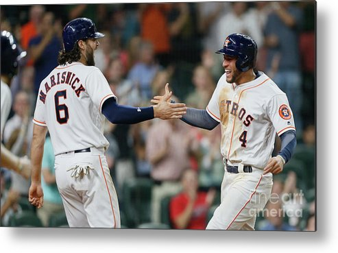 American League Baseball Metal Print featuring the photograph Jake Marisnick and George Springer by Bob Levey