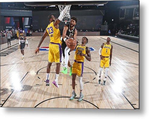 Nba Pro Basketball Metal Print featuring the photograph Jamal Murray and Lebron James by Garrett Ellwood