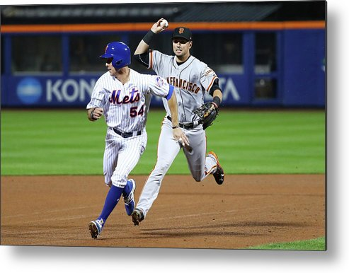 Playoffs Metal Print featuring the photograph Joe Panik and Brandon Crawford by Al Bello