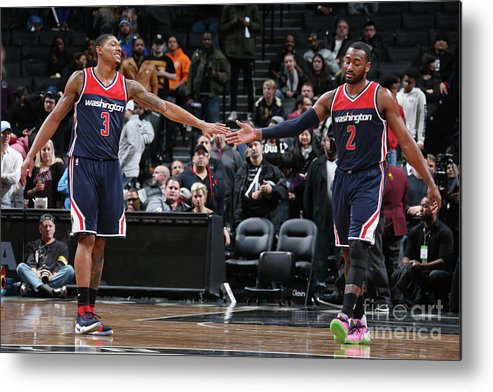 Nba Pro Basketball Metal Print featuring the photograph John Wall and Bradley Beal by Nathaniel S. Butler