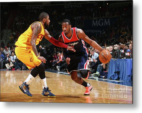 Nba Pro Basketball Metal Print featuring the photograph John Wall and Kyrie Irving by Ned Dishman