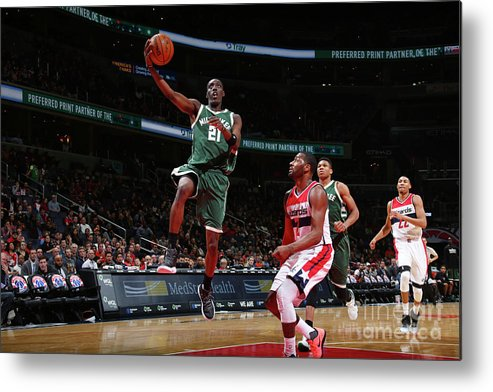 Nba Pro Basketball Metal Print featuring the photograph John Wall and Tony Snell by Ned Dishman
