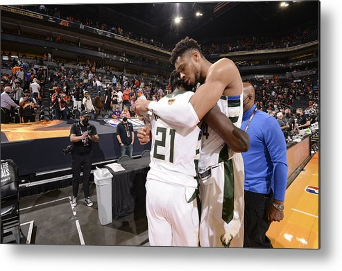 Playoffs Metal Print featuring the photograph Jrue Holiday and Giannis Antetokounmpo by Andrew D. Bernstein