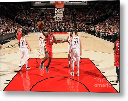 Nba Pro Basketball Metal Print featuring the photograph Jrue Holiday by Cameron Browne