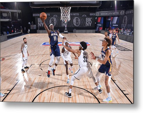 Nba Pro Basketball Metal Print featuring the photograph Jrue Holiday by Jesse D. Garrabrant