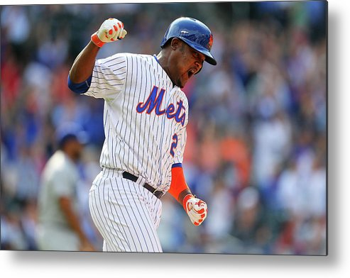 Three Quarter Length Metal Print featuring the photograph Juan Uribe by Mike Stobe