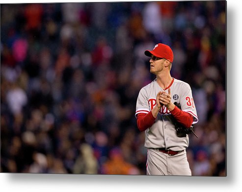 Defeat Metal Print featuring the photograph Justin Morneau and Kyle Kendrick by Justin Edmonds