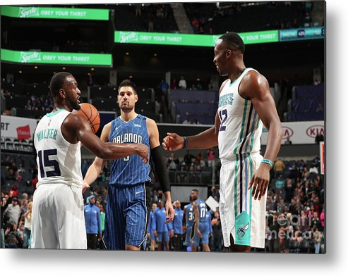 Kemba Walker Metal Print featuring the photograph Kemba Walker and Dwight Howard by Kent Smith