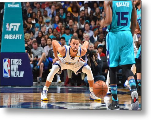 Kemba Walker Metal Print featuring the photograph Kemba Walker and Stephen Curry by Jesse D. Garrabrant
