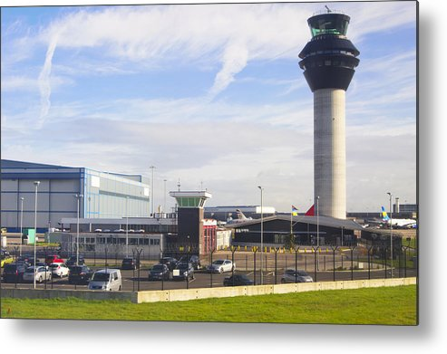 Tranquility Metal Print featuring the photograph Manchester airport. by Mark Williamson