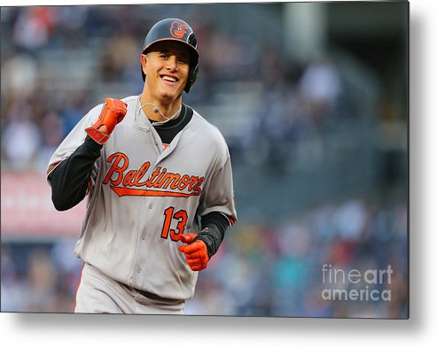Three Quarter Length Metal Print featuring the photograph Manny Machado and Matt Wieters by Mike Stobe