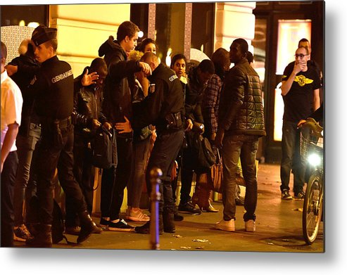 November 2015 Paris Attacks Metal Print featuring the photograph Many Dead After Multiple Shootings In Paris by Pascal Le Segretain