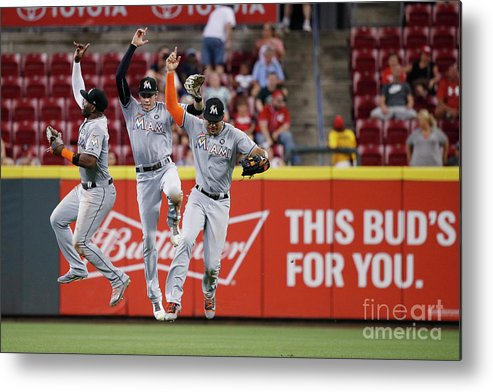 Great American Ball Park Metal Print featuring the photograph Marcell Ozuna, Christian Yelich, and Giancarlo Stanton by Joe Robbins