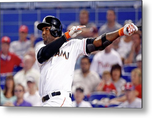 American League Baseball Metal Print featuring the photograph Marcell Ozuna by Rob Foldy