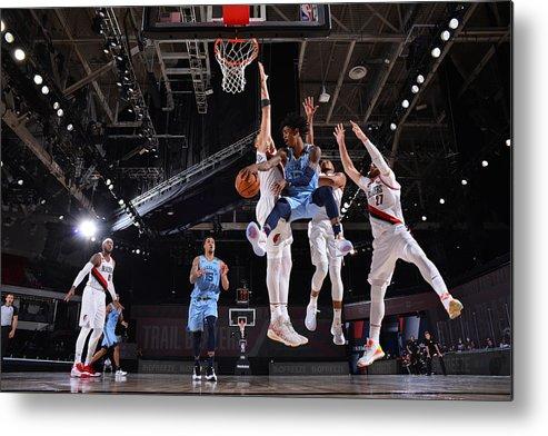 Nba Pro Basketball Metal Print featuring the photograph Memphis Grizzlies v Portland Trail Blazers by Jesse D. Garrabrant
