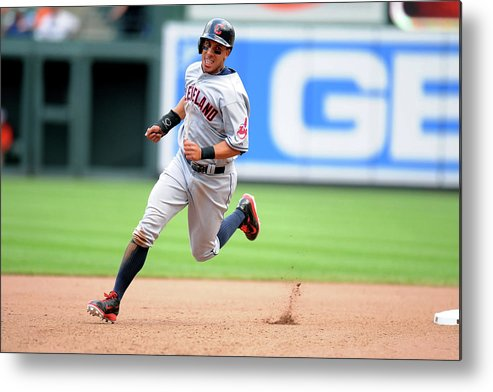 American League Baseball Metal Print featuring the photograph Michael Brantley and Lonnie Chisenhall by Mitchell Layton