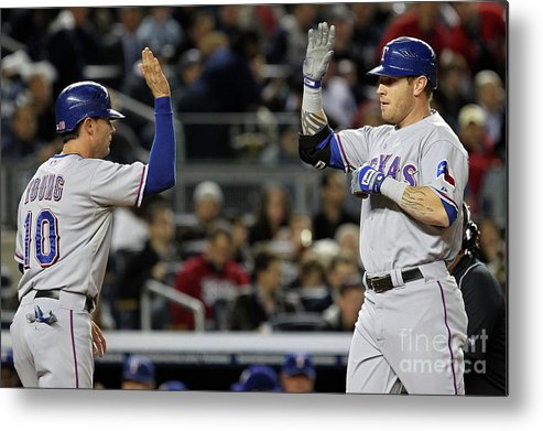 Playoffs Metal Print featuring the photograph Michael Young and Josh Hamilton by Al Bello