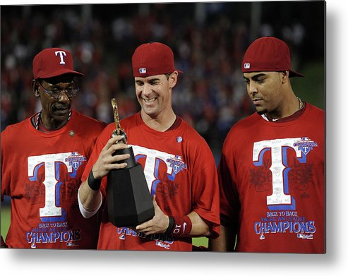 American League Baseball Metal Print featuring the photograph Michael Young, Nelson Cruz, and Ron Washington by Harry How