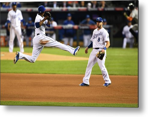 Playoffs Metal Print featuring the photograph Mike Moustakas and Alcides Escobar by Rob Tringali