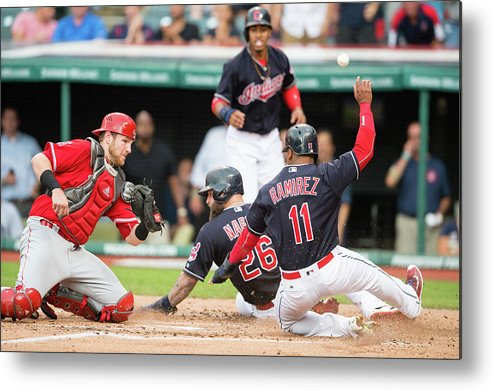 Baseball Catcher Metal Print featuring the photograph Mike Napoli, Lonnie Chisenhall, and Jett Bandy by Jason Miller