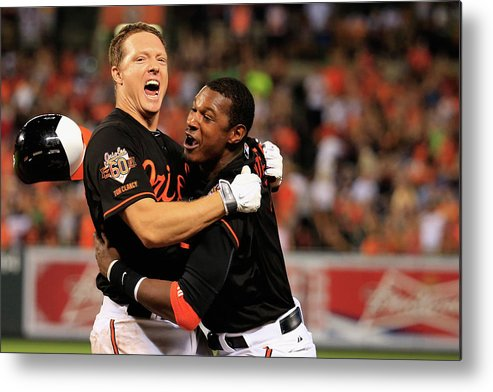 American League Baseball Metal Print featuring the photograph Nick Hundley and Adam Jones by Rob Carr